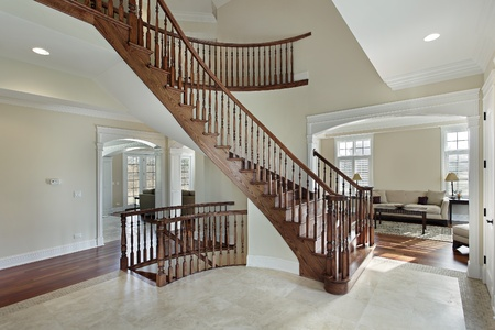 Foyer in luxury home with curved staircase photo