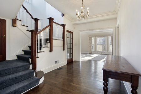 Foyer in traditional home with brown and white staircase photo