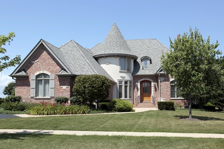 turret: Brick home with turret and cedar roof