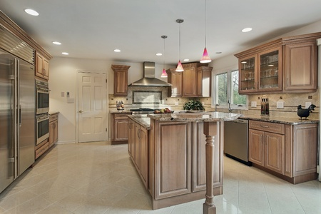 Kitchen in remodeled home with wood cabinetry Stock Photo