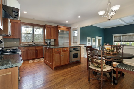 Upscale kitchen with island and family room view