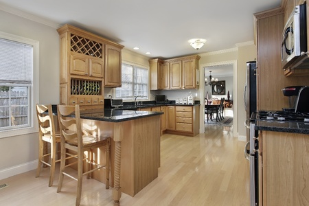 Kitchen with breakfast bar and oak wood cabinetry