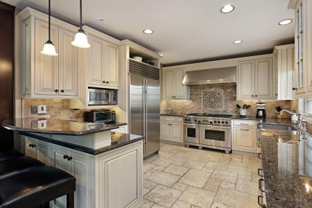 Upscale kitchen in luxury home with breakfast bar Foto de archivo