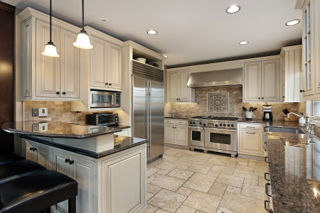 real kitchen: Upscale kitchen in luxury home with breakfast bar Stock Photo