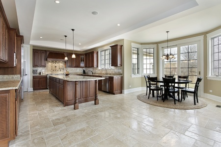 Large kitchen in luxury home with eating area
