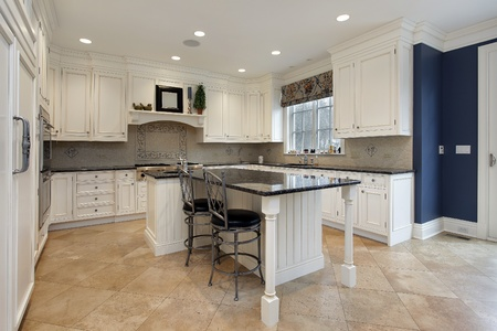 Upscale kitchen in luxury home with granite island photo
