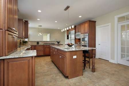 furnishings: Kitchen in luxury home with large center island