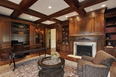 home lighting: Library in luxury home with marble fireplace
