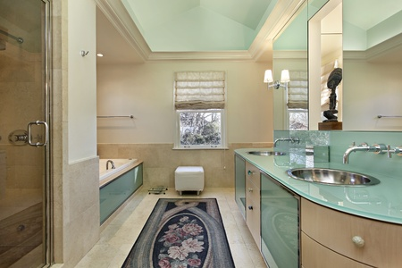 Master bath with lime green vanity and vaulted ceiling