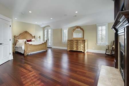 Large Master Bedroom With Cherry Wood Flooring Stock Photo Picture