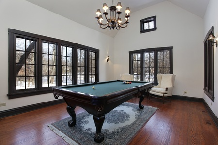 Pool room in suburban home with wall of windows Stock Photo