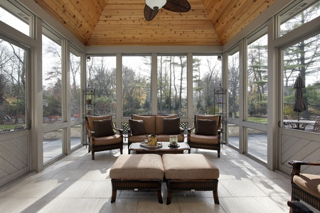 Porch in luxury home with wood ceiling photo