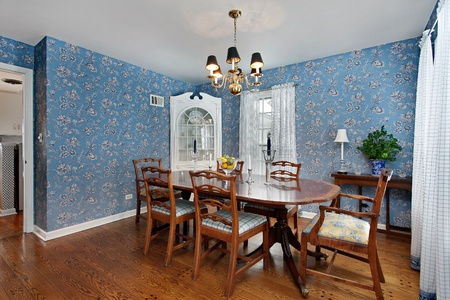 upscale: Dining room in traditional home with blue wallpaper Stock Photo