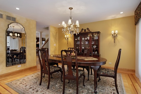 Dining room with buffet and gold walls