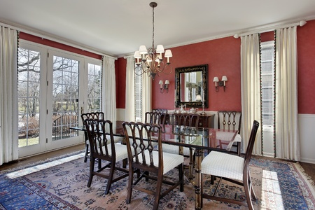 Dining room with red walls and glass table