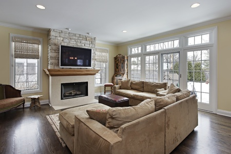 Family room with wood and stone fireplace Stock Photo