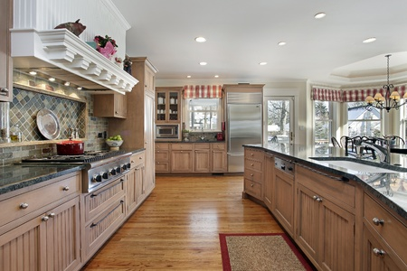 upscale: Large kitchen in modern home with eating area Stock Photo