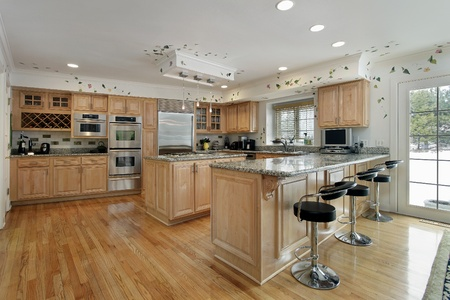 Large kitchen with oak wood cabinetry and island