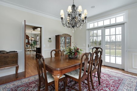 Dining room in suburban home with doors to deck Stock Photo - 14976212