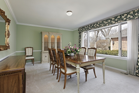 Dining room in traditional home with lime green walls Stock Photo - 14976236
