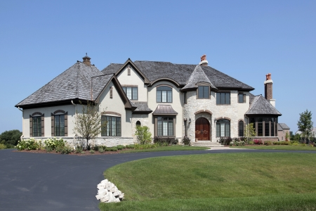 Large suburban white home with front turret photo