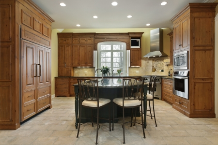 Kitchen in luxury home with center island photo