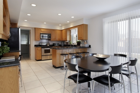 Kitchen in comtemporary home with large eating area photo