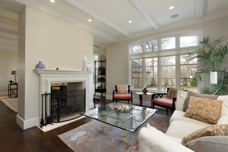family  room: Living room in luxury home with fireplace