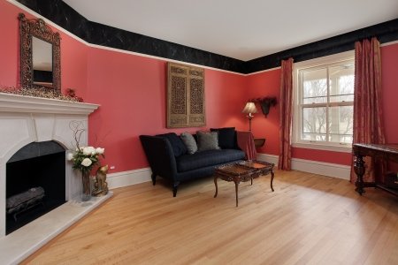 Living room with red walls and fireplace photo