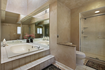 master bath: Master bath in luxury home with mirrored tub Stock Photo