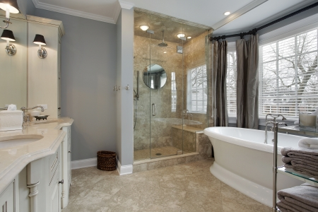bathroom interior: Master bat in luxury home with glass shower Stock Photo