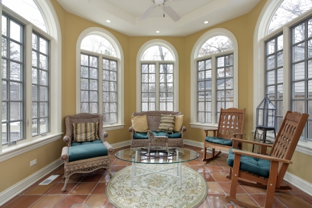 Sunroom in luxury home with terra cotta floors Stock Photo