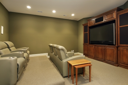 Theater room in luxury home with leather chairs