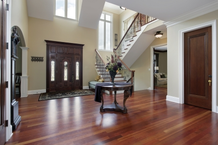 Foyer in luxury home with cherry wood flooring