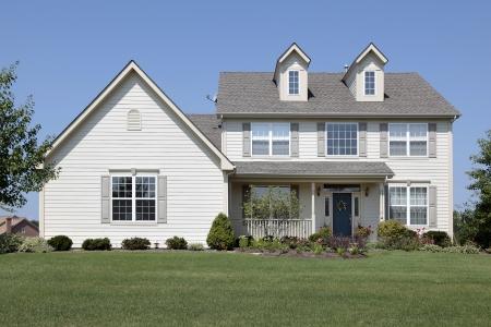Home in suburbs with blue door Editorial