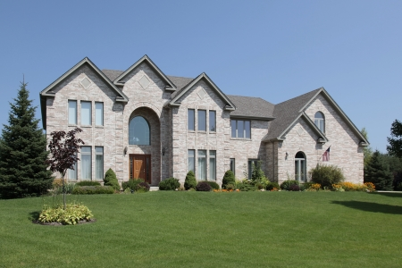 Large suburban home with arched entry