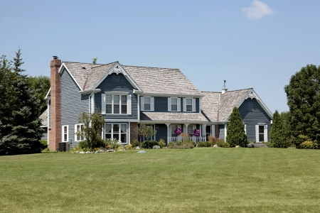 expensive: Suburban home with blue siding and front porch Editorial