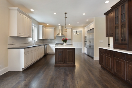 kitchen cabinets: Kitchen in new construction home with center island