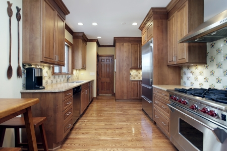 Kitchen in home with oak wood cabinetry Editorial