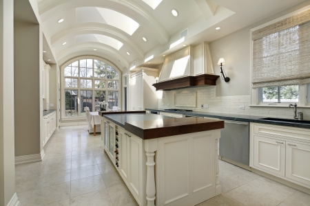 Large kitchen in luxury home with curved ceiling
