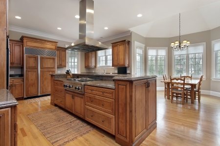 kitchen island: Kitchen in luxury home with wood and granite island