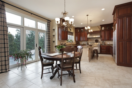 kitchen island: Kitchen with center island and eating area