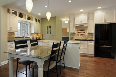 lighting fixtures: Kitchen with granite island and table Editorial