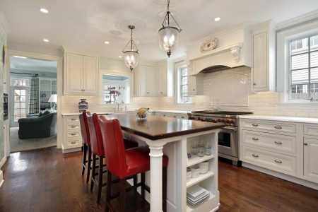 kitchen furniture: Kitchen in luxury home with wood counter island