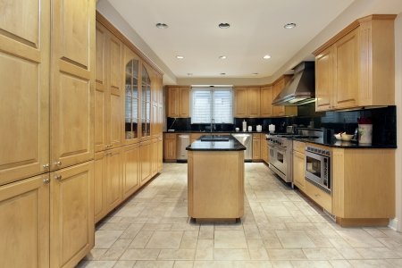 Kitchen in luxury home with black granite counters Editorial