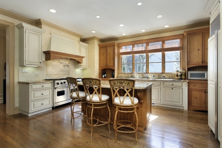 Kitchen in luxury home with granite island counter