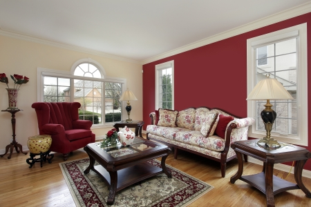Living room in suburban home with red and cream colored walls Editorial