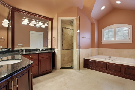 Master bathroom in luxury home with salmon colored walls Editorial