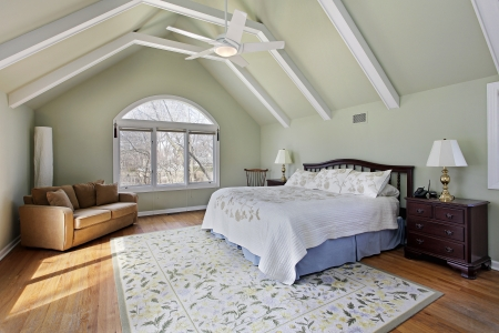 Master bedroom with ceiling beams and large window Stock Photo - 23889114