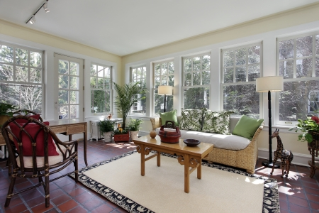 sunroom: Sunroom in suburban home with red brick flooring Editorial